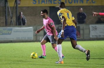 Enfield's Mario Noto (L) and Staines' Bayley Brown