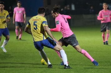 Staines' Ben Martin (L) and Enfield's Sam Youngs