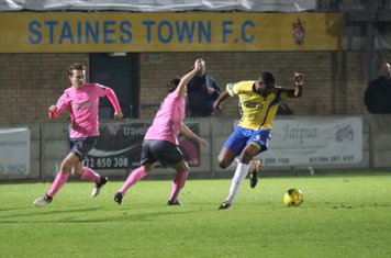 Enfield's Mickey Parcell (L) and Drew Roberts and Staines' Bayley Brown