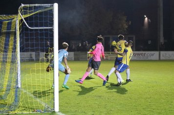 Staines' Ben Martin (5) clears