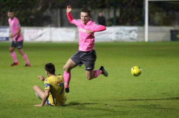 Staines' Lewis Driver (7) challenges Mickey Parcell