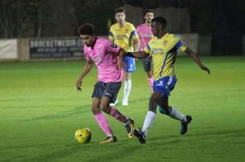 Enfield's Montell Moore (L) and Staines' Wadah Ahmidi