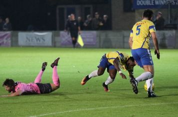 Enfield's Drew Roberts (L) and Staines' Tyrell Miller-Rodney collide in what the referee defined to be a legal shoulder charge