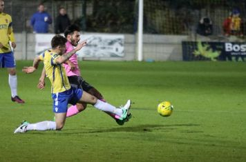 Staines' Lewis Driver (yellow) and Enfield's Mario Noto