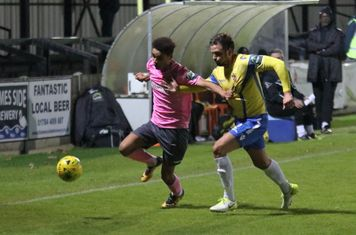 Enfield's Montell Moore (L) and Staines' Josh Webb