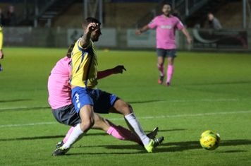 Enfield's Mickey Parcell (pink) and Staines' Tommy Brewer