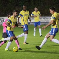 Staines' Tommy Brewer (yellow, L) and Ben Martin combine to close down Ryan Blake