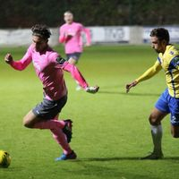 Enfield's Sam Youngs (L) and Staines' Josh Webb
