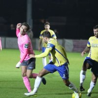 Enfield's Sam Youngs (L) and Staines' Tommy Brewer (R) and Josh Webb