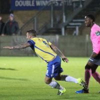 Staines' Tommy Brewer (L) and Enfield's Ryan Blake