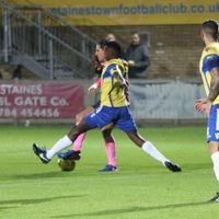 Staines' Wadah Ahmidi (yellow) challenges Sam Youngs