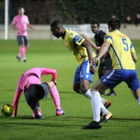 Staines' Bayley Brown and Ben Martin (5) and Enfield's Sam Youngs