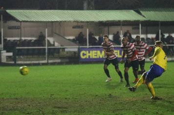 Ryan Blackman scores Enfield's goal from the penalty spot