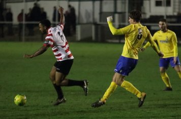 Enfield's Sam Youngs (yellow) and Kingstonian's Leo Chambers