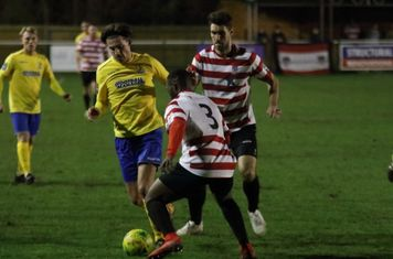 Enfield's Sam Youngs and Kingstonian's Andrew Musungu (3) and Manolis Gogonas