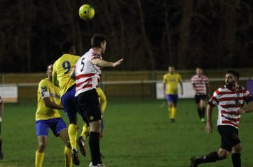 Kingstonian's Sean Francis (5) heads clear from Ryan Blake