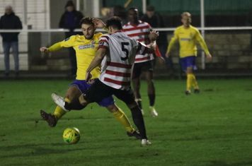Enfield's Jack Hockney (yellow) and Kingstonian's Sean Francis