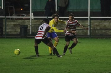 Enfield's Sam Youngs and Kingstonian's Leo Chambers (6) and Manolis Gogonas