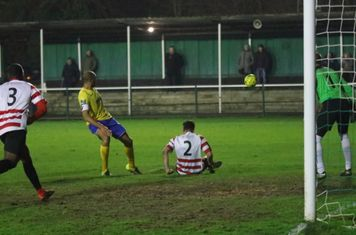 Kingstonian's Manolis Gogonas (2) clears from a sedentary position
