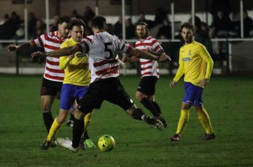 Kingstonian's Sean Francis (5) clears from Sam Youngs