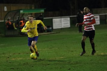 Enfield's Mickey Parcell breaks clear of Marvin Elliott but the referee stops play for an Enfield free kick