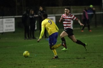 Enfield's Ryan Blake (yellow) and Kingstonian's Louie Theophanous