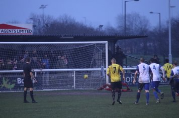 Kingstonian's Jerry Amoo (14) completes the scoring with a late penalty
