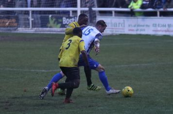 Enfield's Liam Hope challenged by Rob Bartley and Andrew Musungu (3)