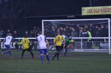 Kingstonian keeper Rob Tolfrey turns the ball away from the onrushing Brad Wadkins