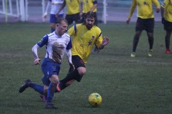 Enfield's Ryan Blackman (L) and Kingstonian's Tom Beere