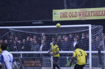 Kingstonian's Freddy Yao looks concerned but Sam Youngs' header hits the bar and bounces to safety