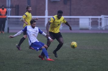 Enfield's Tyler Campbell (L) and Kingstonian's Freddy Yao