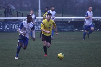 Enfield's Ryan blake (L) and Kingstonian's Greg Cundle