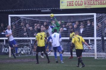 Kingstonian keeper Rob tolfrey challenged by Ryan Blake