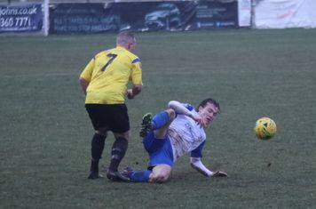 Enfield's Mickey Parcell (R) and Kingstonian's Nic Ciardini