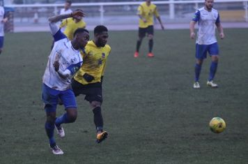 Enfield's Ryan Blake (L) and Kingstonian's Andre McCollin