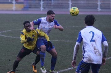 Kingstonian's Andre McCollin (L) and Enfield's Adam Martin and Mickey Parcell (2)