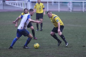 Enfield's Brad Wadkins and Kingstonian's Nic Ciardini (R) and Tom Beere