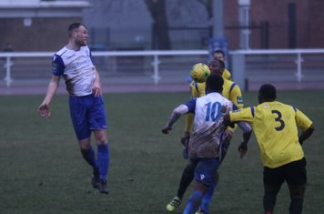 Enfield's Brad Wadkins (L) and Ryan Blake and Kingstonian's Andrew Musungu (3) and Rob Bartley