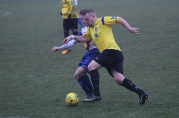 Enfield's Ryan Blackman challenges Nic Ciardini (yellow)