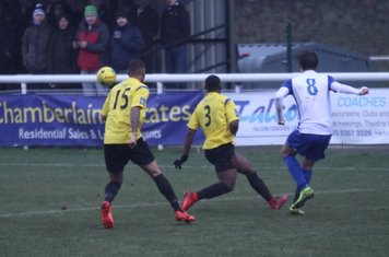 Enfield's Sam Youngs crosses despite the attentions of Connor Hunte (15) and Andrew Musungu
