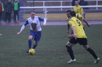 Enfield's Ryan Blackman and Kingstonian's Michael West (9) and Connor Hunte