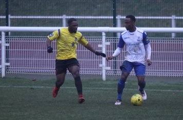 Kingstonian's Andrew Musungu (L) and Enfield's Ryan Blake