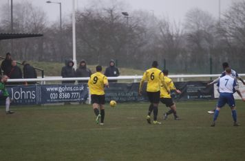 Enfield's Ryan Blake (obscured by no 7, Ryan Blackman) hits the post from the edge of the box