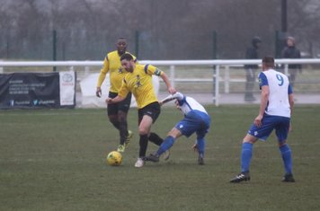 Kingstonian's Michael West (yellow) challenged by Ryan Blackman