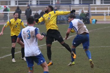 Kingstonian's Andre McCollin (yellow, R) and Michael West and Enfield's Adam Martin (R) and Samir Bihmoutine