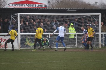 Kingstonian keeper Rob Tolfrey saves from Taofiq Olomowewe (4)