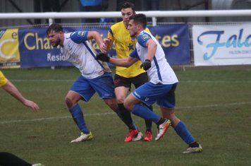 Enfield's Adam Martin (L) and Samir Bihmoutine and Kingstonian's Greg Cundle