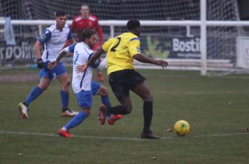 Kingstonian's Freddy Yao (2) runs at Tyler Campbell