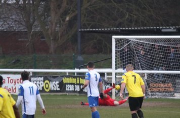Enfield keeper Joe Wright is beaten by Connor Hunte's long-range shot